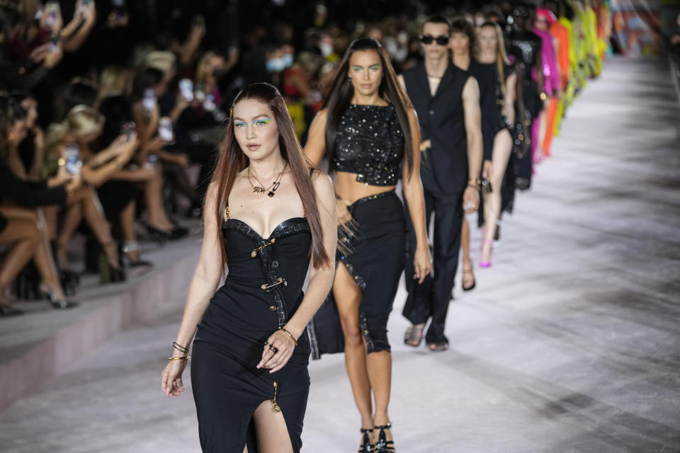 Gigi Hadid, from centre left, and Irina Shayk, lead models as they wear creations for the Versace Spring Summer 2022 collection during Milan Fashion Week, in Milan, Italy, Friday, Sept. 24, 2021. (AP Photo/Luca Bruno)
