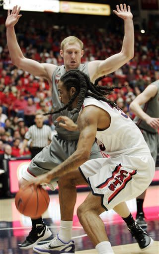 Arizona's Jesse Perry, front, drives into Washington States' Abe Lodwick during the first half of an NCAA college basketball game in Tucson, Ariz., Thursday, Jan. 26, 2012. (AP Photo/John Miller)