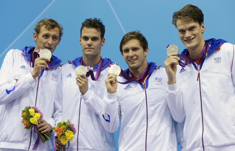 From left, France's Amaury Leveaux, France's Gregory Mallet, France's Clement Lefert and France's Yannick Agnel pose with their silver medals for the men's 4x200-meter freestyle relay swimming final at the Aquatics Centre in the Olympic Park during the 2012 Summer Olympics in London, Tuesday, July 31, 2012. (AP Photo/Michael Sohn)