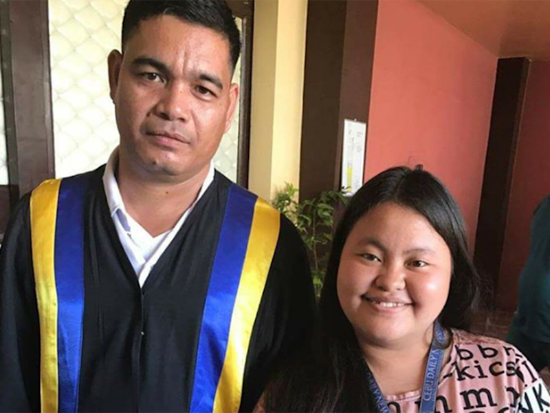 Erwin Macua (left), joined by a local journalist, has graduated with a Bachelor of Elementary Education degree: Mich Padayhag