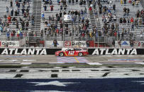 NASCAR Cup Series driver Ryan Blaney wins a NASCAR Cup Series at Atlanta Motor Speedway on Sunday, March 21, 2021, in Hampton, Ga. (AP Photo/Brynn Anderson)