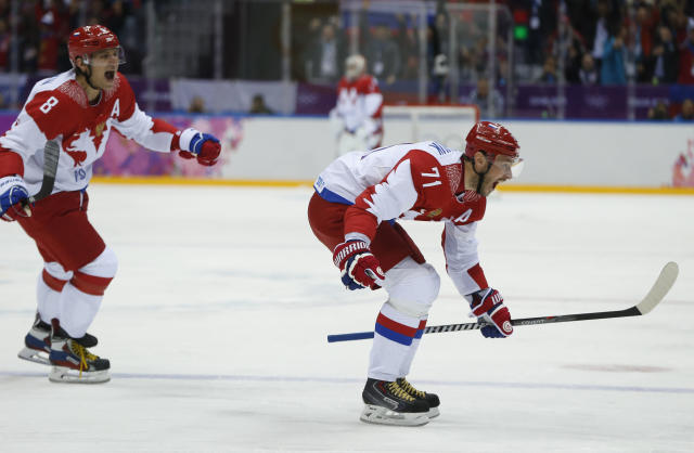 Russia forward Ilya Kovalchuk and Russia forward Alexander Ovechkin react after Kovalchuk scored a goal against Finland in the first period of a men's quarterfinal ice hockey game at the 2014 Winter Olympics, Wednesday, Feb. 19, 2014, in Sochi, Russia. (AP Photo/Julio Cortez)