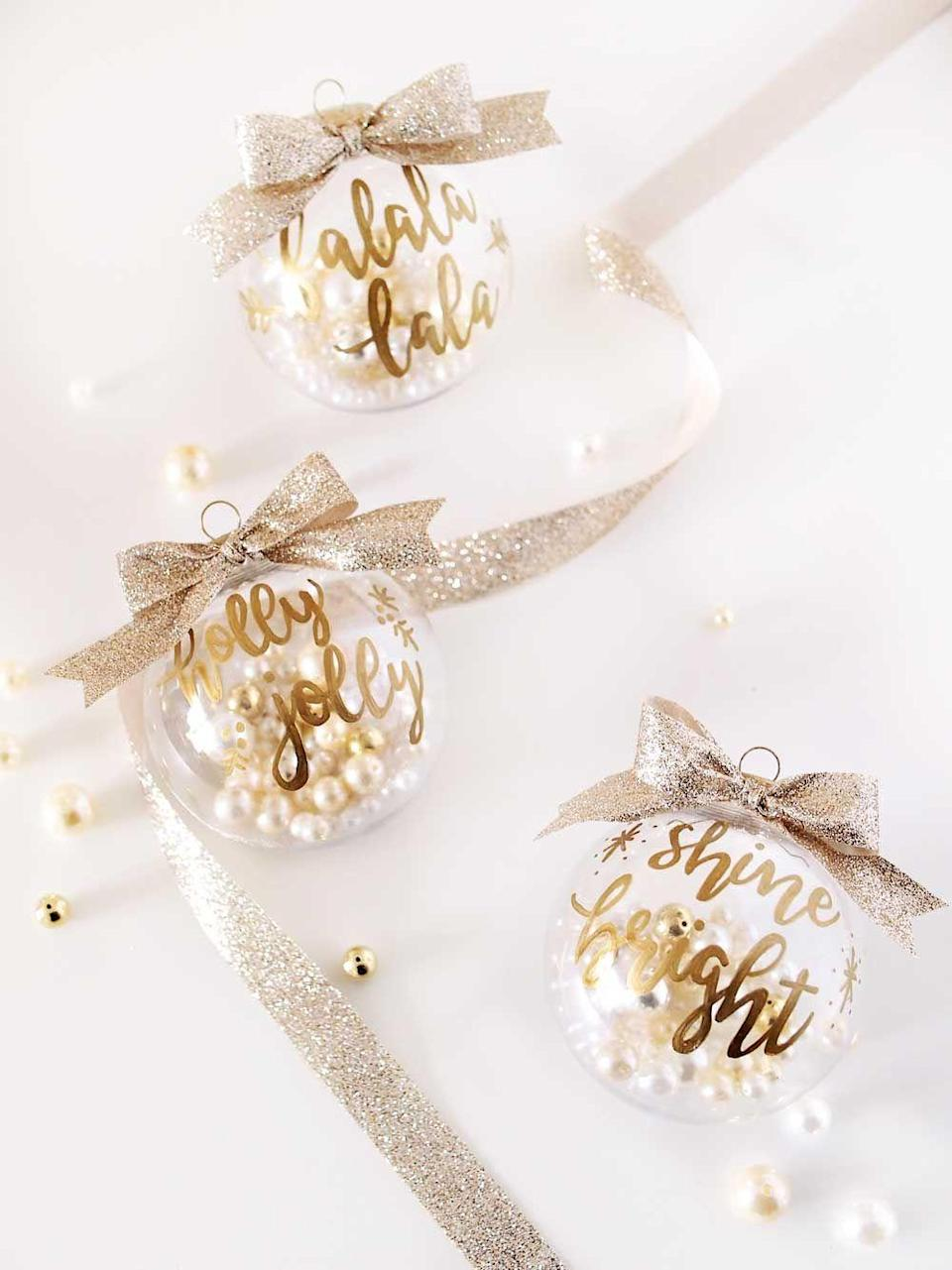 """<p>Don't worry: You don't need impressive calligraphy skills to create these beauties at home. This blogger's tutorial makes it easy to replicate her fancy designs.</p><p><strong>Get the tutorial at <a href=""""http://www.tingandthings.com/2017/12/diy-gold-hand-lettering-christmas-ornaments.html"""" rel=""""nofollow noopener"""" target=""""_blank"""" data-ylk=""""slk:Ting and Things"""" class=""""link rapid-noclick-resp"""">Ting and Things</a>.</strong></p><p><strong><a class=""""link rapid-noclick-resp"""" href=""""https://www.amazon.com/Sharpie-Oil-Based-Markers-Assorted-Metallic/dp/B000I0VMJU/?tag=syn-yahoo-20&ascsubtag=%5Bartid%7C10050.g.1070%5Bsrc%7Cyahoo-us"""" rel=""""nofollow noopener"""" target=""""_blank"""" data-ylk=""""slk:SHOP GOLD MARKERS"""">SHOP GOLD MARKERS</a><br></strong></p>"""