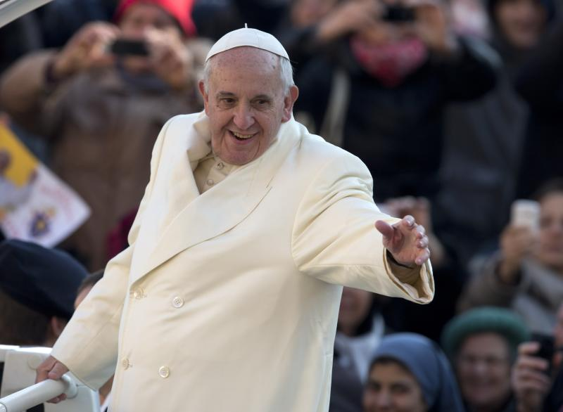 Pope Francis waves as he arrives for his weekly general audience in St. Peter's Square at the Vatican, Wednesday, Dec. 11, 2013. Pope Francis has been selected by Time magazine as the Person of the Year. In only his first year, the Pope was selected by the magazine's editors as the person who had the greatest impact on the world, for good or bad, during 2013. (AP Photo/Alessandra Tarantino)