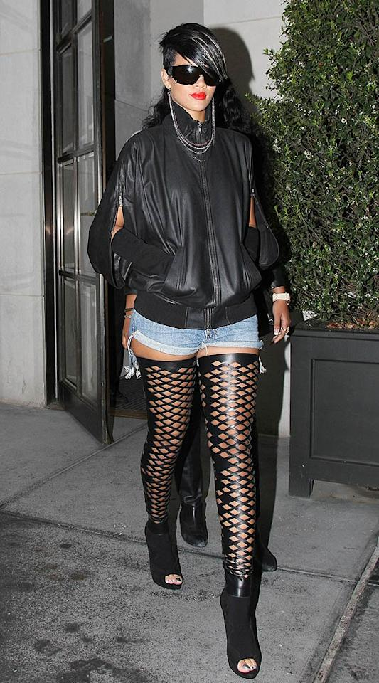 "Rihanna's legs are rockin', but attempting to accentuate them in $950 Rodarte leather cut-out thigh highs, Daisy Dukes, and peep toe booties was a major mistake ... as was her decision to sport that necklace-earring combo! Daniel/Sean/<a href=""http://www.infdaily.com"" target=""new"">INFDaily.com</a> - May 5, 2009"