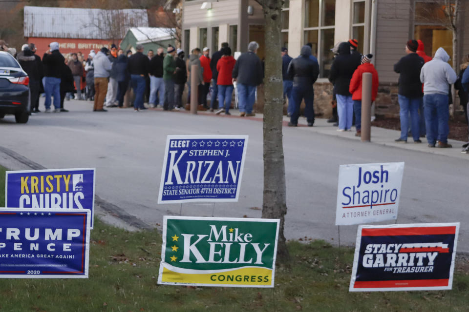 """FILE - In this Nov. 3, 2020, file photo, people line up completely surrounding the Jackson Township Municipal Building, before the polls open for Election Day in Jackson Township, Pa. State Sen. Doug Mastriano, R-Franklin, said in a statement Wednesday, July 7, 2021, that, as chair of the Senate Intergovernmental Operations Committee, he issued letters to several counties, requesting """"information and materials needed to conduct a forensic investigation of the 2020 General Election and the 2021 Primary."""" (AP Photo/Keith Srakocic, File)"""