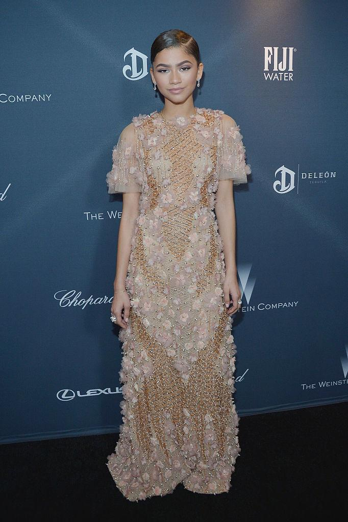 <p>For a pre-Oscar dinner, the actress-turned-singer donned a heavily embroidered number by Marchesa. <em>[Photo: Getty]</em> </p>