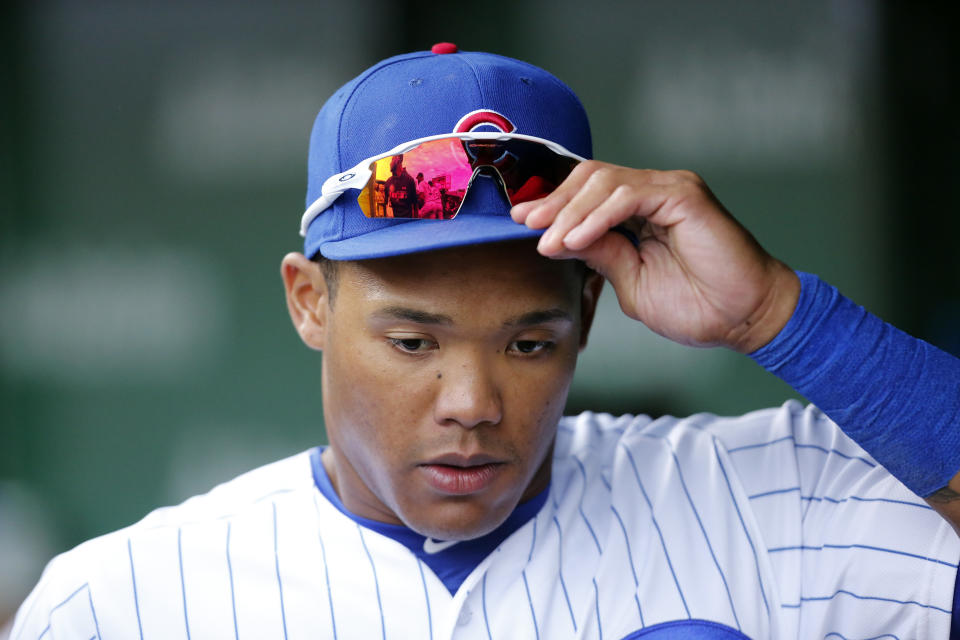 CHICAGO, ILLINOIS - AUGUST 31: Addison Russell #27 of the Chicago Cubs stands in the dugout during the game against the Milwaukee Brewers at Wrigley Field on August 31, 2019 in Chicago, Illinois. (Photo by Nuccio DiNuzzo/Getty Images)