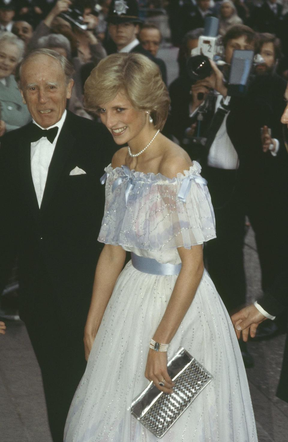 <p>Diana's 1983 evening gown was jazzed up by yet another metallic clutch, this one with quilted texture, at the Royal Albert Hall in London.</p>