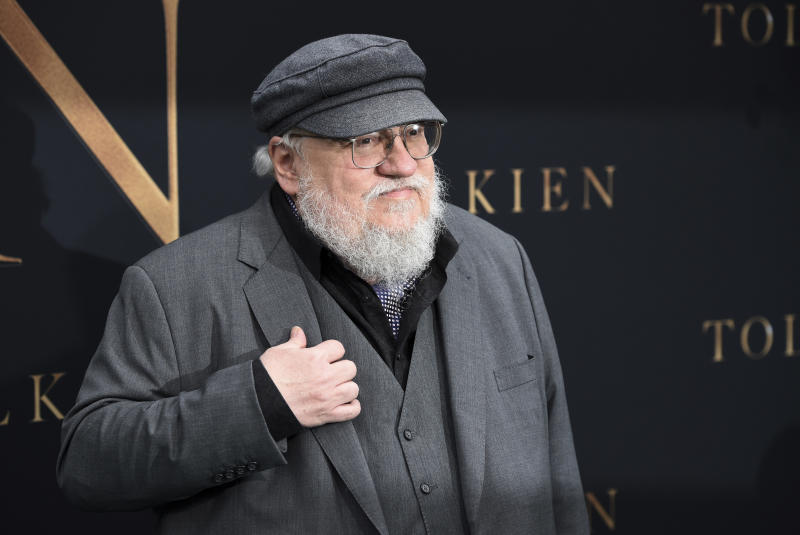 "Author George R.R. Martin poses at the premiere of the film ""Tolkien"" at the Regency Village Theatre, Wednesday, May 8, 2019, in Los Angeles. The film explores the formative years of J.R.R. Tolkien, author of the classic fantasy novels ""The Hobbit"" and ""The Lord of the Rings."" (Photo by Chris Pizzello/Invision/AP)"
