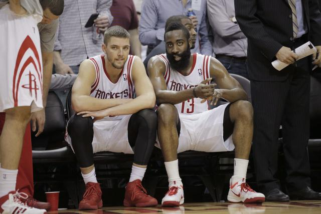 Mar 9, 2014; Houston, TX, USA; Houston Rockets small forward Chandler Parsons (25) and shooting guard James Harden (13) sit on the bench during the fourth quarter against the Portland Trail Blazers at Toyota Center. (Andrew Richardson-USA TODAY Sports)