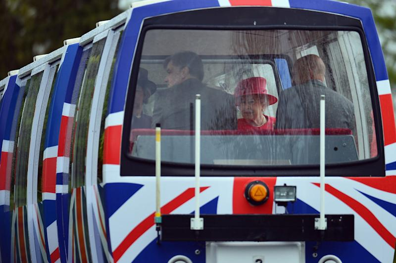 Queen Elizabeth II travels on a monorail during a visit to Chester Zoo as part of her tour of the North West on May 17, 2012 in Chester, England.