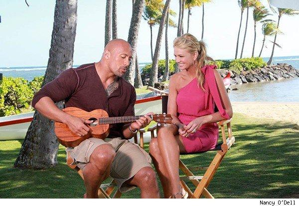 The Rock serenades Nancy O'Dell on the beach in Hawaii