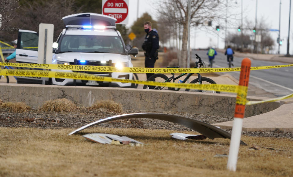 A piece of debris from a commercial airplane is marked off by police tape where it landed along Midway Boulevard in Broomfield, Colo., as the plane shed parts while making an emergency landing at nearby Denver International Airport Saturday, Feb. 20, 2021. (AP Photo/David Zalubowski)