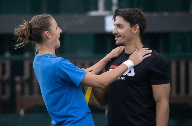 Karolina Pliskova looked relaxed at her practice session with husband Michal Hrdlicka