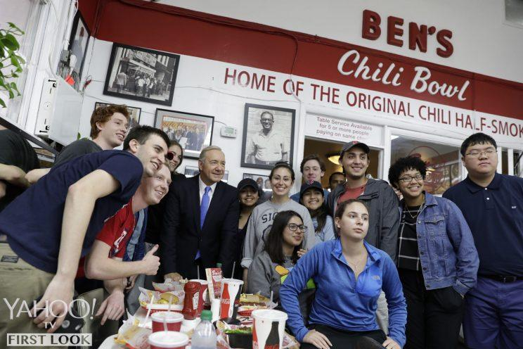 President Underwood joins the crowd for a group photo at Ben's Chili Bowl