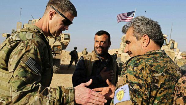 PHOTO: U.S. Army Maj. Gen. Jamie Jarrard (L), thanks Manbij Military Council commander Muhammed Abu Adeel during a visit to a small outpost near the town of Manbij, northern Syria, Feb. 7, 2018. (Susannah George/AP)