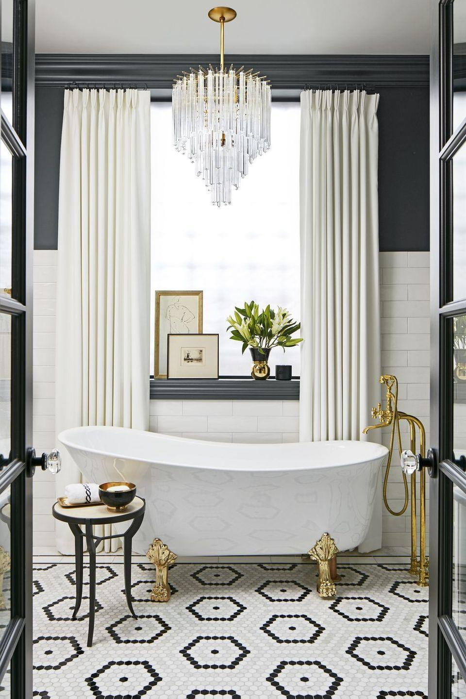 <p>A black-and-white palette doesn't have to be boring. In this bathroom, a wall of black paint and white subway tile along with hexagon patterned flooring create visual interest. </p>