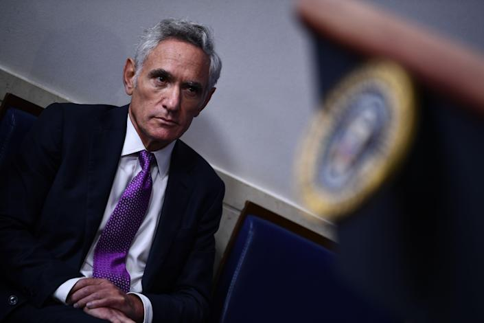 Dr. Scott Atlas listens to President Trump during a briefing at the White House August 10,. (Brendan Smialowski/AFP via Getty Images)