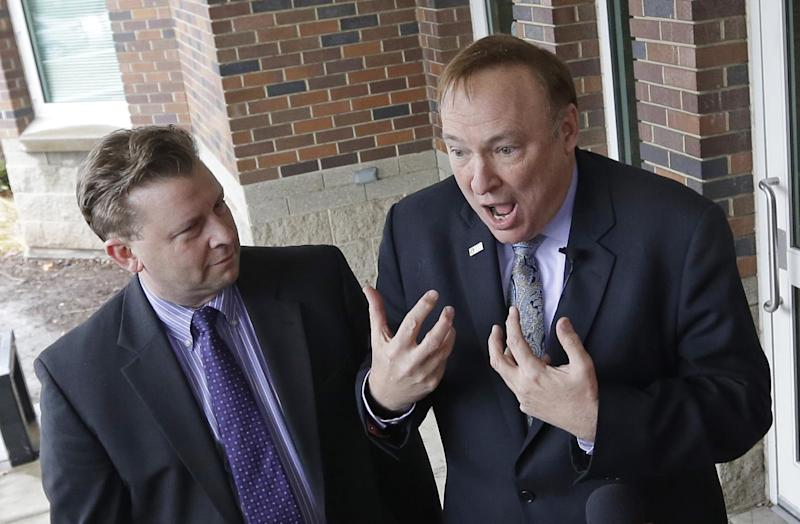 """Sen. Todd Weiler, R-Woods Cross, left, and Sen. Jim Dabakis, D-Salt Lake City, speak to reporters in the doorway of Uintah Elementary School before stoping in for school lunch Thursday, Jan. 30, 2014, in Salt Lake City. A school district apologized Thursday to outraged parents after about 30 students at a Salt Lake City school had their lunches thrown out because of outstanding balances on their food accounts. Salt Lake City School District spokesman Jason Olsen said the district is investigating what happened at Uintah Elementary and working to make sure it doesn't happen again. """"This was a mistake. This was handled wrong,"""" Olsen said during a news conference outside the school. (AP Photo/Rick Bowmer)"""
