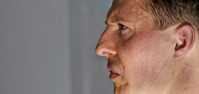 """FILE - In this March 12, 2010 file photo Mercedes Grand Prix driver Michael Schumacher of Germany is pictured in the garage after finishing the second practice session at the Formula One Bahrain International Circuit in Sakhir, Bahrain. Schumacher is being treated at a hospital in Grenoble after sustaining a head injury during a ski accident in Meribel, France. Doctors treating Michael Schumacher refused Monday, Dec. 30, 2013 to predict the outcome for the former Formula One driver, saying they were taking his very critical head injury """"hour by hour"""" following his ski accident. Chief anesthesiologist Jean-Francois Payen told reporters that the seven-time champion is still in a medically induced coma. (AP Photo/Ben Curtis, File)"""