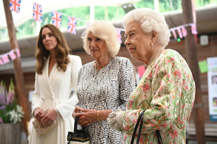 ST AUSTELL, ENGLAND - JUNE 11: Catherine, Duchess of Cambridge (L), Camilla, Duchess of Cornwall (C) and Queen Elizabeth II meet people from communities across Cornwall at an event in celebration of The Big Lunch initiative at The Eden Project during the G7 Summit on June 11, 2021 in St Austell, Cornwall, England. UK Prime Minister, Boris Johnson, hosts leaders from the USA, Japan, Germany, France, Italy and Canada at the G7 Summit. This year the UK has invited India, South Africa, and South Korea to attend the Leaders' Summit as guest countries as well as the EU. (Photo by Oli Scarff - WPA Pool / Getty Images)