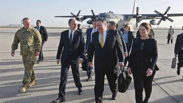 PHOTO: Secretary of State Mike Pompeo, second right, and his wife Susan, right, is welcomed by U.S. ambassador to Iraq Douglas Silliman, second left, as they arrive in Baghdad, Iraq, during a Middle East tour, Jan. 9, 2019. (Andrew Caballero-Reynolds/Pool via AP))