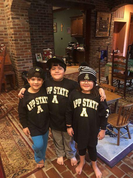 PHOTO: After a weeks-long battle with COVID-19, Dr. Grant Lashley reunited with his children, 9-year-old Wyatt (center) and 7-year-old twins Cody (left) and Weston (right). (Courtesy of the Lashley Family )