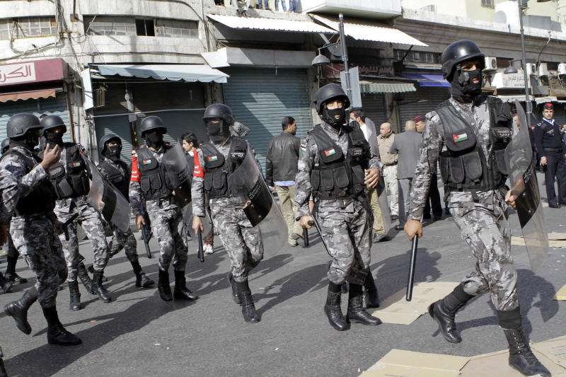 Jordanian riot police approach protesters who tried to bypass a designated demonstration area after Friday prayers in Amman, Jordan, Friday, Nov. 16, 2012. Larger groups have demonstrated in Amman since the unrest sparked by fuel price hikes started three days ago, but Friday's march constituted the biggest single bloc yet to call for the end of the U.S.-backed monarch's regime. The crowd of some 2,500 also chanted slogans reminiscent of last year's uprisings in the region.(AP Photo/Raad Adayleh)