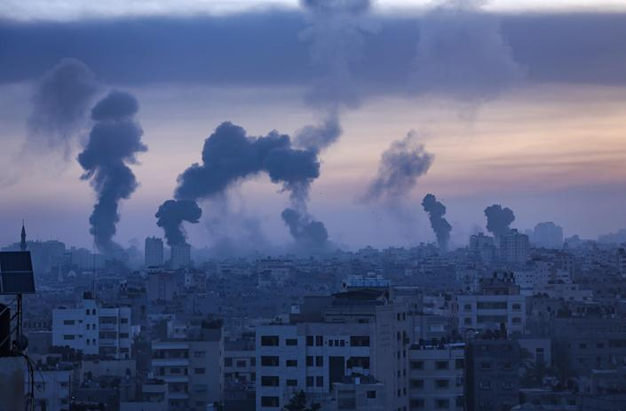 Smoke and flames rise from Gaza City yesterday Wednesday (EPA)