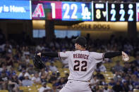Arizona Diamondbacks' Josh Reddick, who normally plays outfield, pitches during the ninth inning of a baseball game against the Los Angeles Dodgers Saturday, July 10, 2021, in Los Angeles. (AP Photo/Mark J. Terrill)
