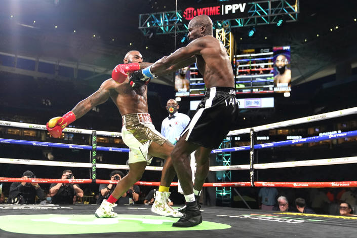 Former NFL wide receiver Chad Johnson, right, and Brian Maxwell fight during an exhibition boxing match at Hard Rock Stadium, Sunday, June 6, 2021, in Miami Gardens, Fla. (AP Photo/Lynne Sladky)
