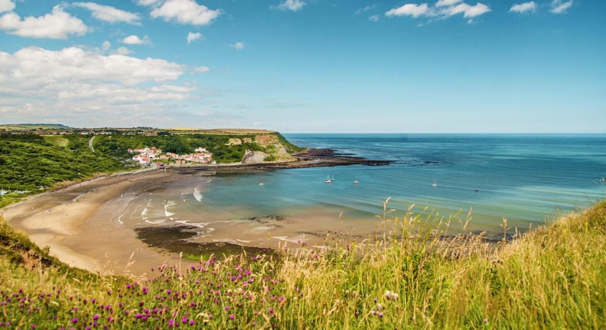 Runswick Bay in North Yorkshire has been named as the second-fastest growing destination for UK travel in 2021 (Getty)
