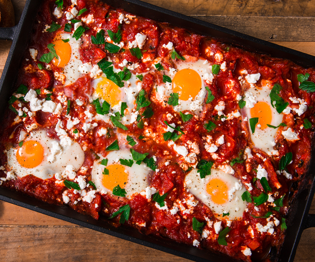 "<p>Shakshuka is by far the easiest way to impress your guests at brunch. It's mildly spicy, full of flavour, and has perfectly runny eggs. </p><p>Get the <a href=""https://www.delish.com/uk/cooking/recipes/a29949777/shakshuka-with-feta-and-parsley-recipe/"" rel=""nofollow noopener"" target=""_blank"" data-ylk=""slk:Shakshuka"" class=""link rapid-noclick-resp"">Shakshuka</a> recipe.</p>"