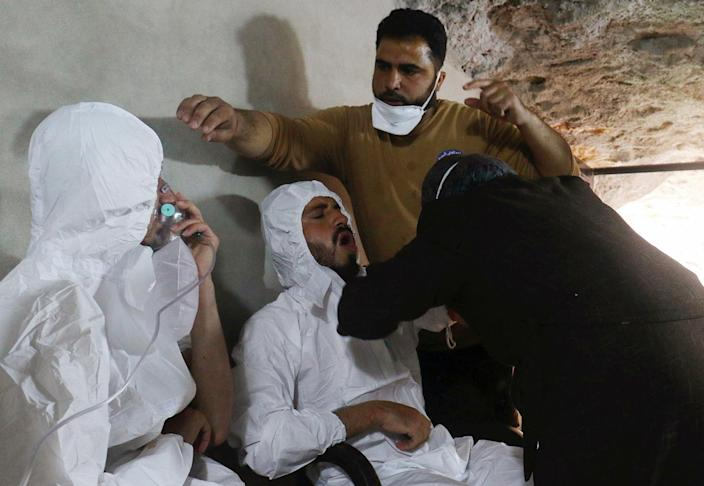 <p>A man breathes through an oxygen mask as another one receives treatments, after what rescue workers described as a suspected gas attack in the town of Khan Sheikhoun in rebel-held Idlib, Syria, April 4, 2017. (Ammar Abdullah/Reuters) </p>