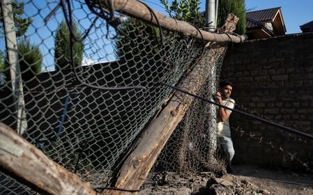 The Wider Image: Barricades and books in restive Kashmir neighbourhood