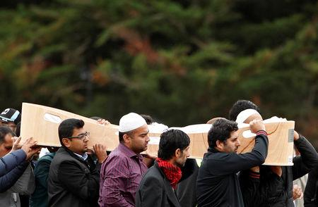 People attend the burial ceremony of Syed Jahandad Ali, 34, a victim of the mosque attacks, at the Memorial Park Cemetery in Christchurch, New Zealand March 22, 2019. REUTERS/Edgar Su