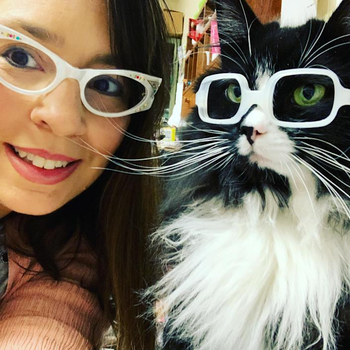 Danielle Crull and Truffles model glasses together. (Courtesy of A Child's Eyes)