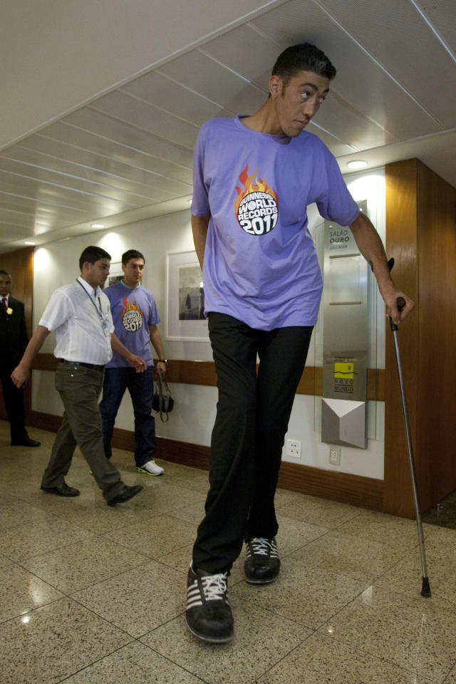 Turkey's Sultan Kosen, 27, the tallest man on earth according to the Guinness World Records organization, with a height of 246.5 cm (8 feet 1 inch), arrives to a news conference in Rio de Janeiro, Brazil, Thursday, Nov. 18, 2010.