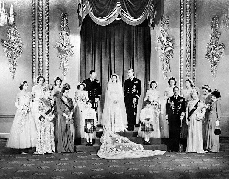 This file photo taken on November 20, 1947 shows Princess Elizabeth (Queen Elizabeth II) and Philip the Duke of Edinburgh on their wedding day in the Throne Room at Buckingham Palace (AFP Photo/STR)