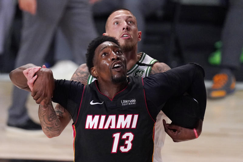 Miami Heat's Bam Adebayo (13) is tied up by Boston Celtics' Daniel Theis (27) during the second half of an NBA conference final playoff basketball game Sunday, Sept. 27, 2020, in Lake Buena Vista, Fla. Adebayo was fouled on the play. (AP Photo/Mark J. Terrill)