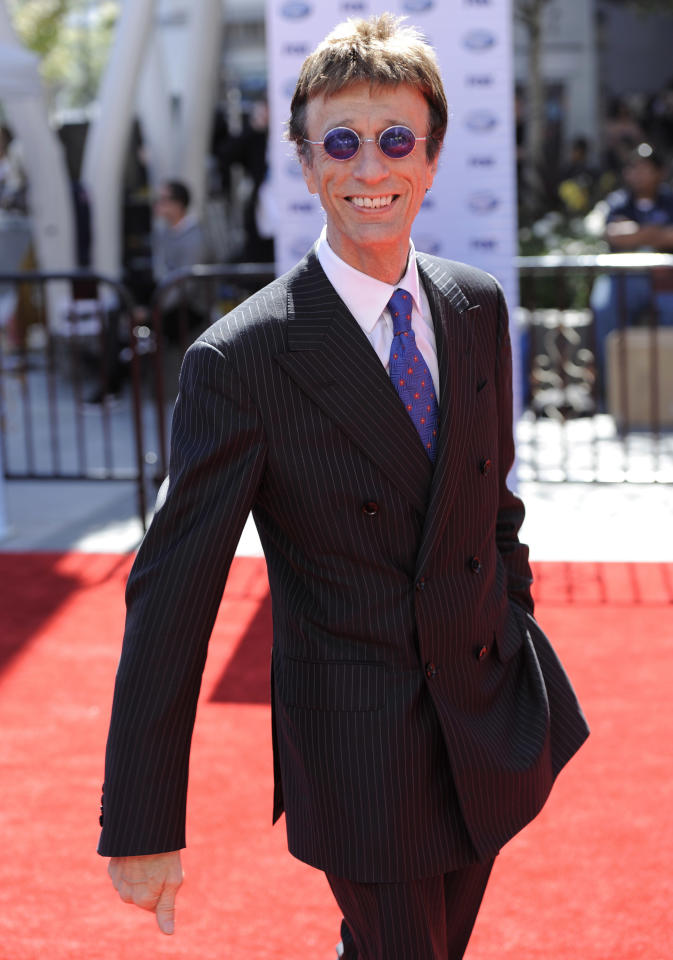"FILE - In this Wednesday, May 26, 2010 file photo Robin Gibb arrives at the ""American Idol"" finale in Los Angeles. Bee Gee Robin Gibb says on his website Wednesday Nov. 23, 2011, that he is recovering from a serious illness. Gibb's extremely gaunt appearance and the cancellation of several public appearances have sparked fears that he is seriously ill. He was hospitalized last month with colon inflammation and other problems but has been discharged. (AP Photo/Chris Pizzello, file)"