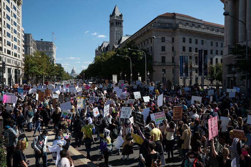 Women's March protesters embark down Pennsylvania Avenue in Washington, D.C. on Oct. 17, 2020.