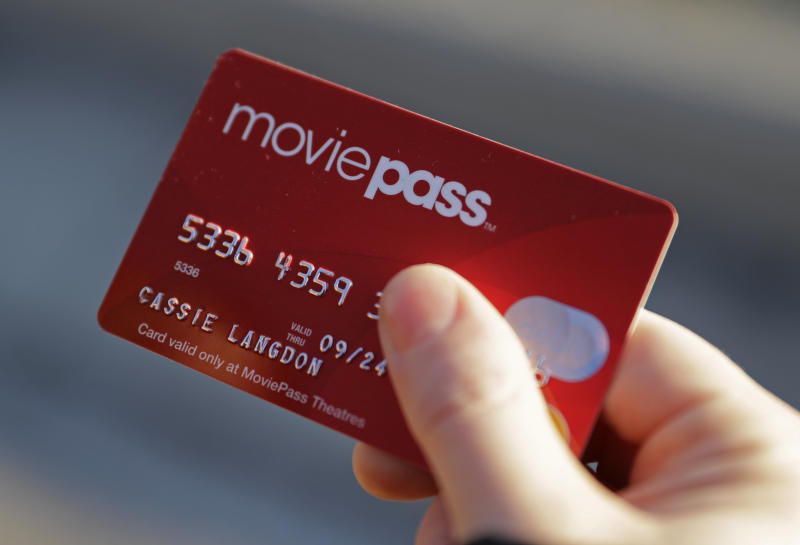 In this Tuesday, Jan. 30, 2018, photo, Cassie Langdon holds her MoviePass card outside AMC Indianapolis 17 theatre in Indianapolis. With MoviePass, Langdon said she's taking more chances on smaller releases instead of sticking with blockbusters and their sequels. (AP Photo/Darron Cummings)