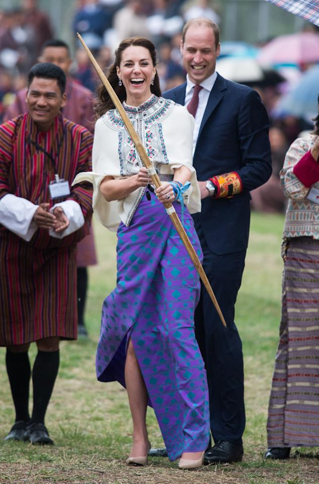 <p></p><p><span>Bringing her A-game to the archery field, Middleton sported pointed-toe pumps while trying her hand at archery on a royal tour of India and Bhutan. Pairing her heels with a colourful wrap skirt and Paul & Joe cape, the Duchess of Cambridge proved she may not have the best aim – but she'll look good regardless. <em>(Photo via Getty Images)</em></span> </p><p></p>