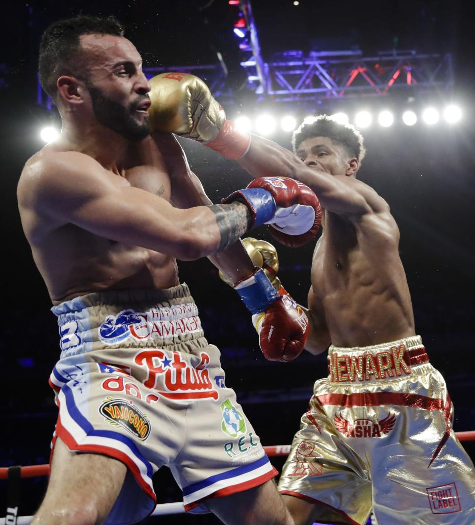 Shakur Stevenson, right, punches Puerto Rico's Christopher Diaz during the sixth round of a IBF Intercontinental and NABO featherweight championship boxing match Saturday, April 20, 2019, in New York. Stevenson won the fight. (AP Photo/Frank Franklin II)