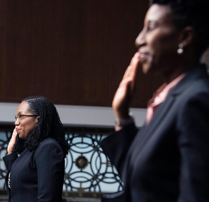 Candace Jackson-Akiwumi, right, nominated to be a judge on the U.S. Court of Appeals for the 7th Circuit, right, and Ketanji Brown Jackson, nominated to the U.S. Court of for the District of Columbia Circuit, are sworn in for a Senate Judiciary Committee hearing April 28.