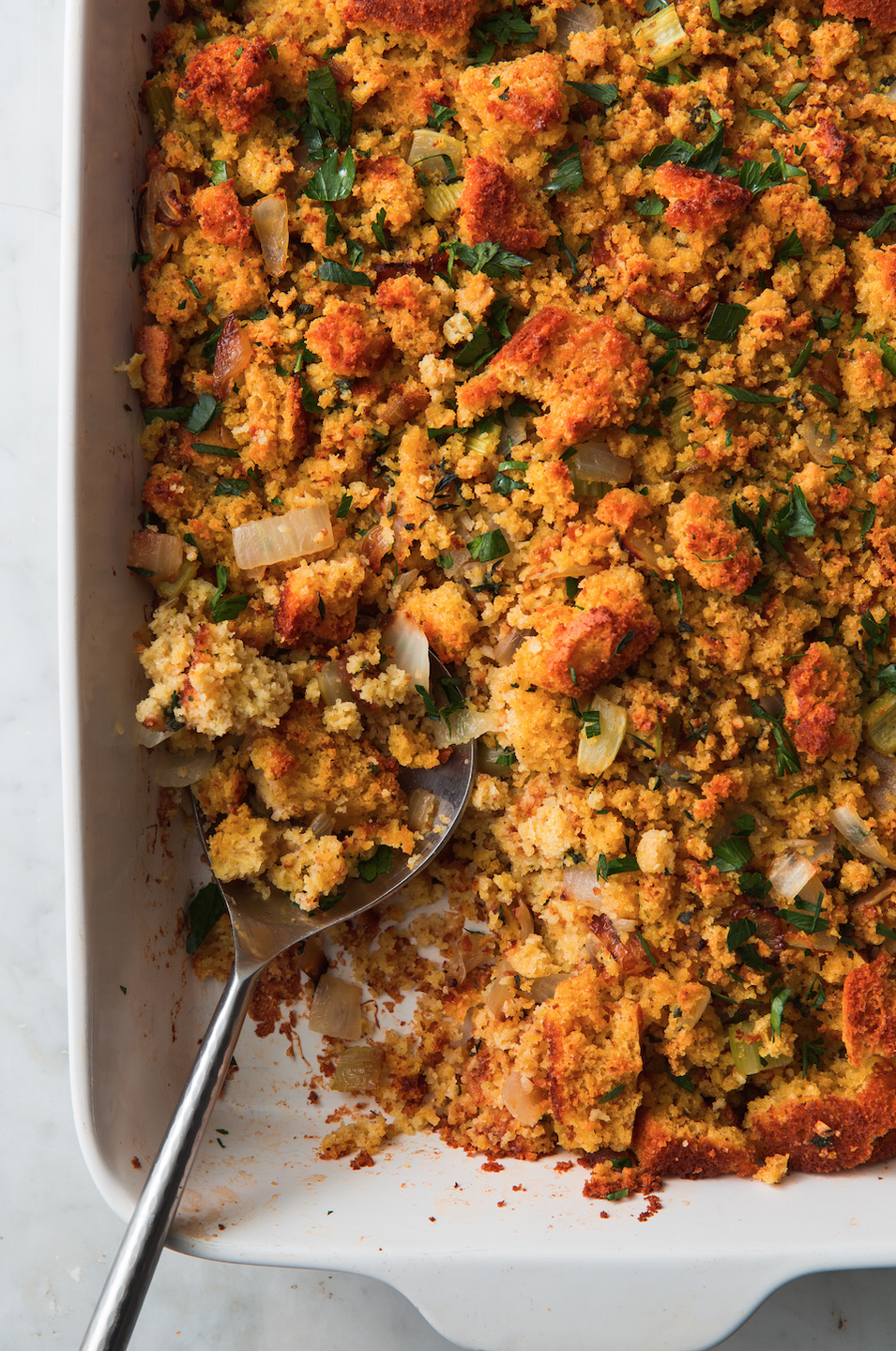 """<p>Make the cornbread the night before to make things easier!</p><p>Get the recipe from <a href=""""https://www.delish.com/cooking/recipe-ideas/a22553283/best-cornbread-stuffing-recipe/"""" rel=""""nofollow noopener"""" target=""""_blank"""" data-ylk=""""slk:Delish"""" class=""""link rapid-noclick-resp"""">Delish</a>. </p>"""