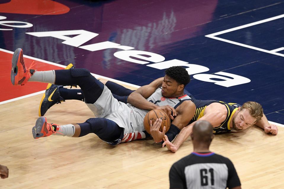 Washington Wizards forward Rui Hachimura, left, and Indiana Pacers forward Domantas Sabonis, right, scramble for the ball during the first half of an NBA basketball Eastern Conference play-in game Thursday, May 20, 2021, in Washington. (AP Photo/Nick Wass)