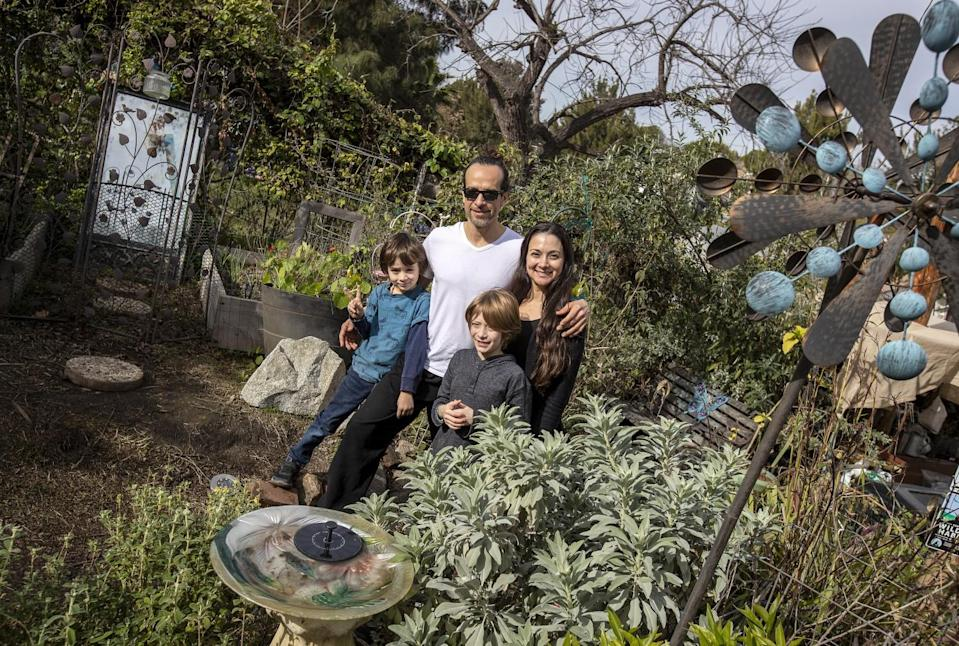 The Terry family in the Arts and Roots garden, which is available for rent.
